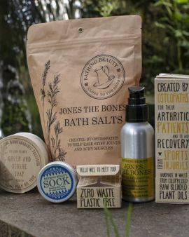 The collection of different products in the beauty collection: Green and Serene Soap, Bath Salts, Sock balm, Muscle and Joint Oil.