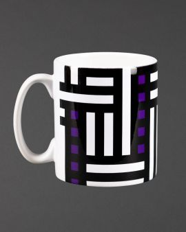 The mug with the Hill House inspired design with a curved handle.