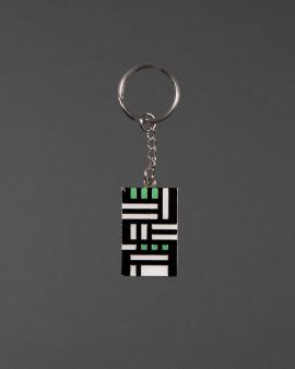A keyring inspired by the Hill House with a chain and round key link.