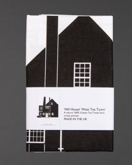 The tea towel featuring the Hill House West Elevation with a label that says 'Hill House West Tea Towel. A natural 100% cotton tea towel hand screen printed. Made in the UK.'