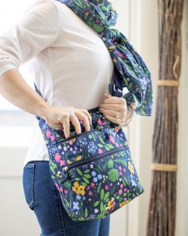 front of flowers and gardens cross body bag, showing strap to side of bag