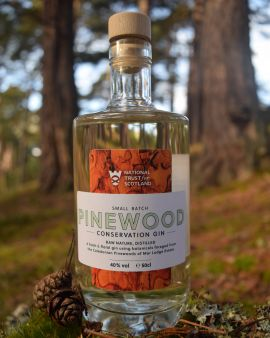 Close up of the front of Pinewood Conservation Gin bottle, in the Mar Lodge Estate