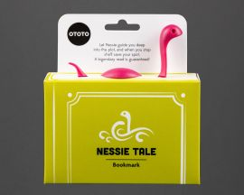 The Nessie Bookmark in its packaging, so it looks as though the Loch Ness Monster is swimming through the book. It says 'Let Nessie guide you deep into the plot, and when you stop she'll save your spot. A legendary read is guaranteed!'