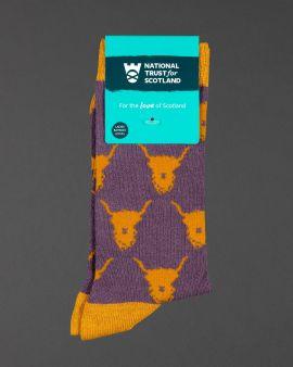 ladies brown socks with orange highland cow pattern