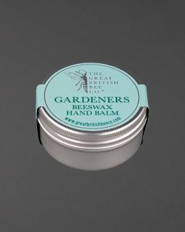 The tin of balm with labelling on top saying Gardeners Beeswax Hand Balm.