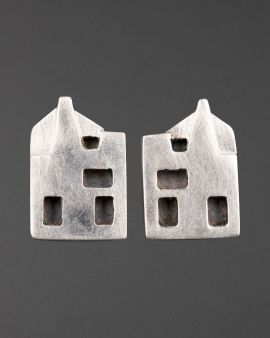 Two stud silver earrings with holes cut out to represent the  west elevation of the Hill House.