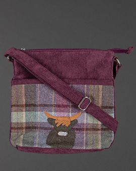 highland cow thistle tweed cross body bag, shown with the strap across the bag