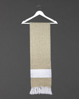 the hamman throw in gooseberry hanging from a white coat hanger