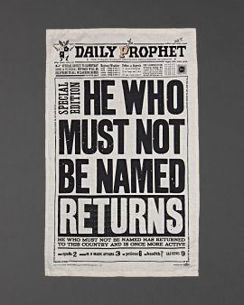 The Harry Potter tea towel featuring the cover of the Daily Prophet Newspaper. It says 'He who must not be named returns.'