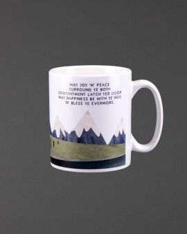 White ceramic mug with handle and the phrase 'May Joy 'n peace.'