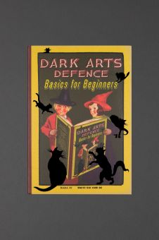 The cover of the Dark Arts Defence notebook. It has two children with witches' hats reading the book on the cover. It says 'Dark Arts Defence Basics for Beginners.'
