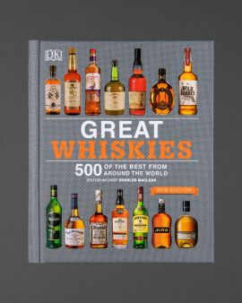 The cover of the book 'Great Whiskies' featuring many different whisky bottles and brands.