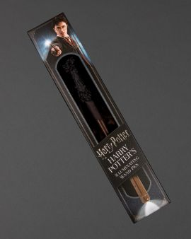 The illuminating Harry Potter Wand in its packaging. There is an image of Harry Potter on the top.