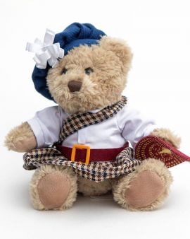 A Jacobite Teddy Bear with a hat, kilt and shield.