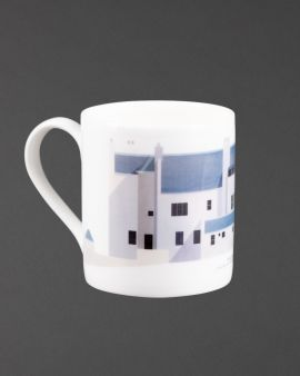 The mug with a curved handle. The mug has the east elevation of the Hill House on it. Underneath it says 'The Hill House Charles Rennie Mackintosh.'