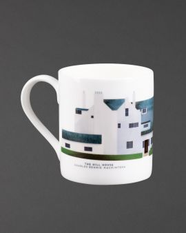 The mug with a curved handle. The mug has the north elevation of the Hill House on it. Underneath it says 'The Hill House Charles Rennie Mackintosh.'