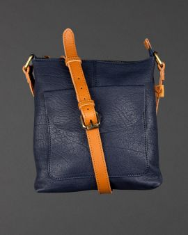 The navy leather bag with a crossover strap and pocket at the front.