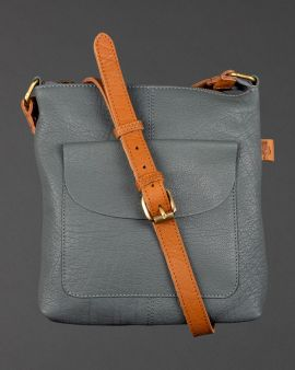 The grey leather bag with a crossover strap and pocket at the front.