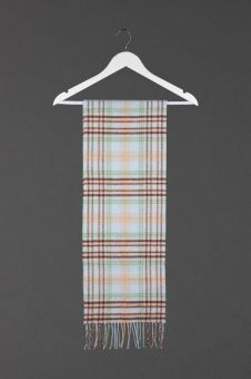 A Landscape and Islands Tartan Cashmere Scarf with a fringe at the bottom.