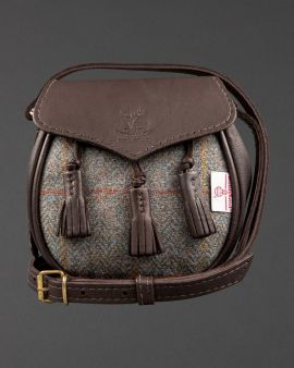 The sporran bag with tassels and leather strap, and a tweed front.