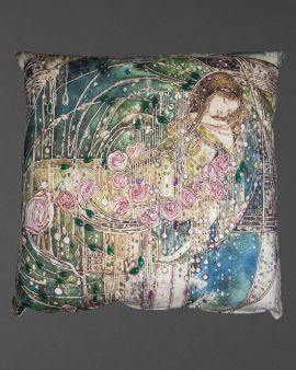 A cushion that features the Sleeping Princess design.