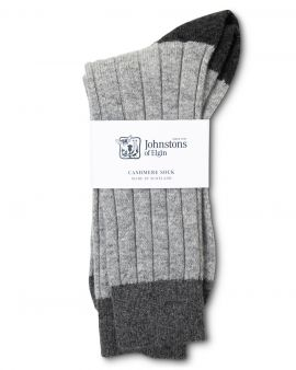 Grey cashmere socks with black toes, with the label 'Johnstons of Elgin.'