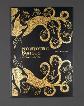 The front cover of the hardback journal: 'Fantastic Beasts and where to find them by Newt Scamander.'