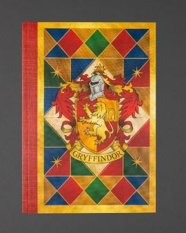 The front cover of the paperback notebook featuring the Gryffindor house crest.