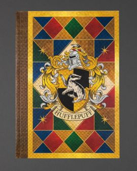The front cover of the paperback notebook featuring the Hufflepuff house crest.