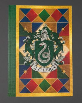 The front cover of the paperback notebook featuring the Slytherin house crest.