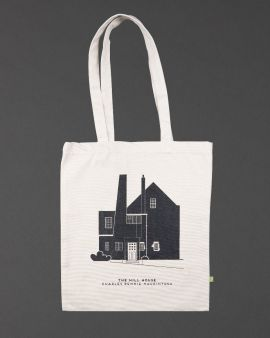 The shopper bag with a long strap, it features the West Elevation of the Hill House. Underneath there is text: 'The Hill House Charles Rennie Mackintosh.'