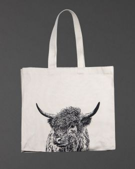 A shopping bag with a large image of a Highland cow in the middle at the bottom.