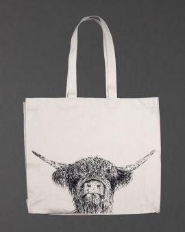 A shopping bag with an illustration of a Highland cow in the middle.