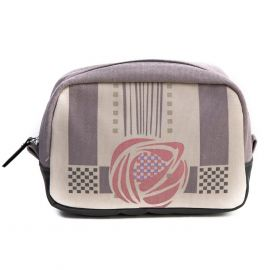 The makeup bag with purple, check detail and featuring a Mackintosh rose. It has a black leather zip.