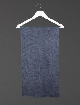 The navy alpaca shawl folded and hanging on a coathanger.
