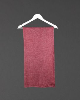 The claret alpaca shawl folded and hanging on a coathanger.
