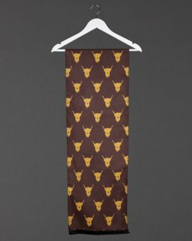 front of highland cow scarf, showing mustard cow on brown background, hanging from white coat hanger