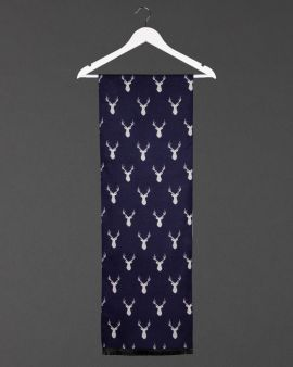 front of stag scarf, showing grey stag on navy background, hanging from a white coat hanger