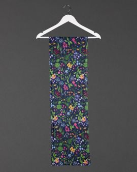 flowers & gardens scarf, hanging draped from a white coat hanger