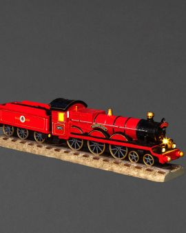The model of the Hogwarts Express on a train track.