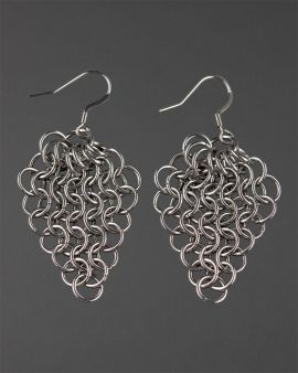 The 2 chain maille silver hook earrings on a wooden background.
