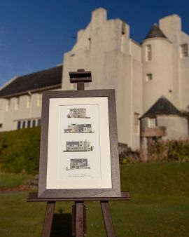 The print in a frame, showing the 4 elevations of the Hill House. The frame is outside the actual Hill House.