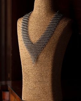 The V-Shaped Stainless Steel necklace on a dressmaker's model.